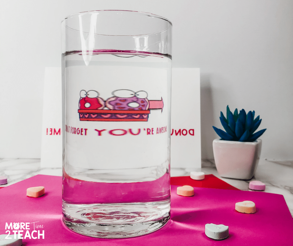 Try this simple light refraction experiment  perfect for Valentine's Day. Help kids see how light bending or refracting helps them read a secret Valentine message. Perfect for an easy science experiment!